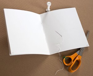Make a working dummy by folding 8 sheets of paper and sewing or stapling them.