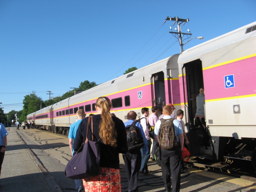 People boarding a commuter train