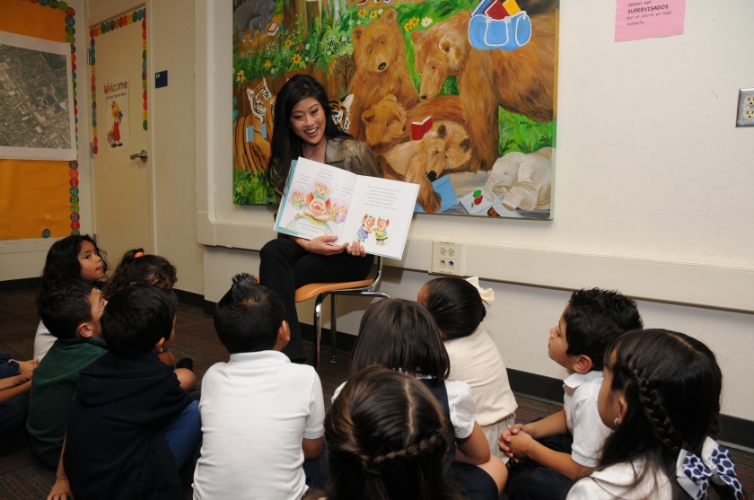 Kristi Yamaguchi shares her book with some fans.