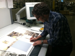 Rob Broder signing off on printer's proofs