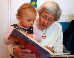grandmother reading to baby