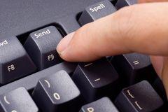 finger-pressing-send-button-6364250