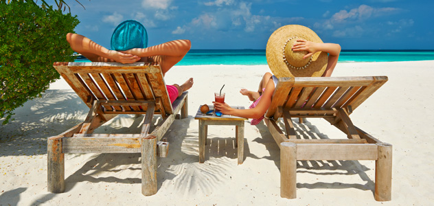 couple-beach-loungers