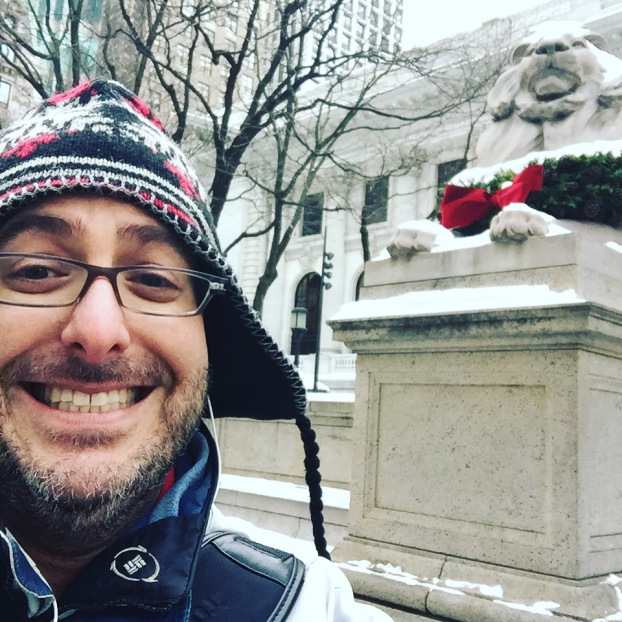 josh with lion statue